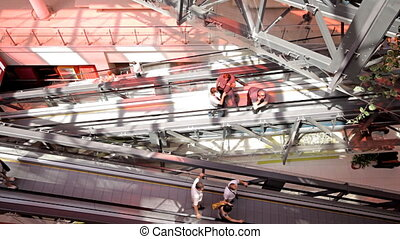 escalator in shopping center - MOSCOW - JUNE 20: People rise...