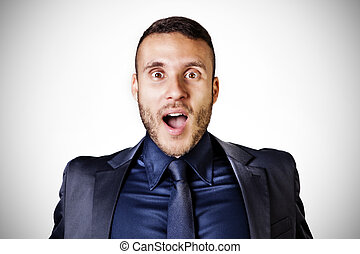 surprised man with blue tie on a white background