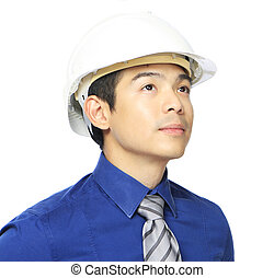 Contemplation - Close-up of a man wearing a hardhat and...