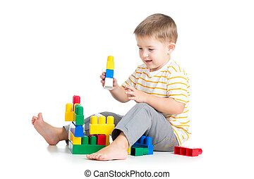kid boy playing with block toy over white background