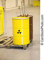nuclear waste - Yellow barrels with radioactive waste...