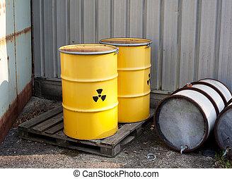 abandoned radioactiv waste - Yellow barrels with radioactive...