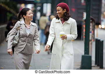City Business Women - Two business women having a...