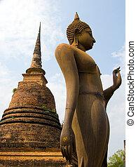 sukhothai buddha - large buddha and monument at sukhothai...