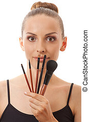 young woman showing her makeup brushes - woman showing her...