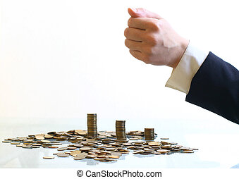 coins piles  - hand make coins piles on white background