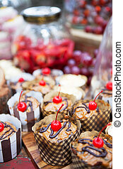Fresh cherry-topped cupcakes and other snacks