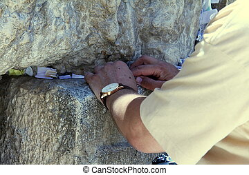 Placing a Note to God in the Wailing Wall - Placing a Note...