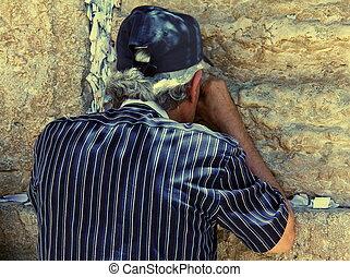 Jewish worshiper praying at the Wailing Wall