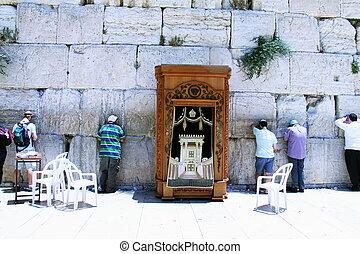 Jewish worshipers pray at the Wailing Wall