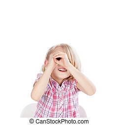 Girl Looking Through Hand Telescope Against White Background...