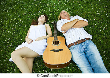 Happy caucasian couple - A happy caucasian couple lying down...