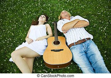 Happy caucasian couple - A happy caucasian couple lying down...