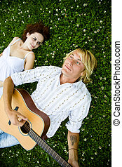 Happy caucasian couple - A happy caucasian couple playing...