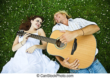 Happy caucasian couple - A happy caucasian couple playing...