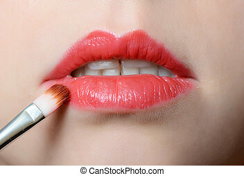 Female lips close up with lipstick