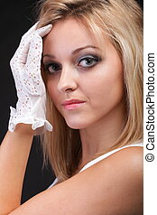 portrait beautiful woman in white gloves