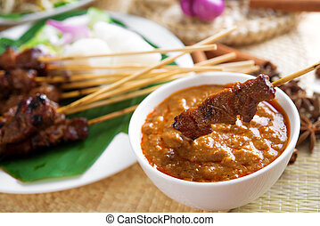 Satay skewered and grilled meat - Satay or sate, skewered...
