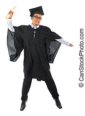 Asian male university student in graduation gown jumping -...