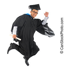 Asian university student in graduation gown - Full body...
