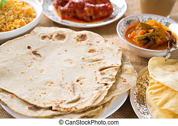 Indian food - Chapatti roti or chapati, curry chicken,...
