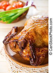 Roast chicken ready to eat, on wooden tray