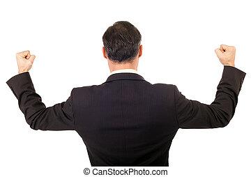 business success - back view victorious businessman raising...