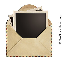 polaroid photo frames in old air post envelope isolated on...