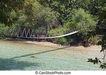 Aheron river in Greece - Rope bridge over Aheron river in...