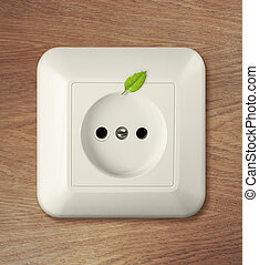 outlet on wooden wall with leaf green power concept