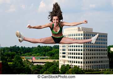 Acrobat - Beautiful woman involved in acrobatic exercise...