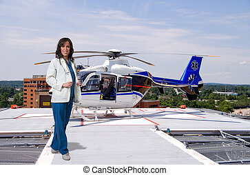 Doctor and Life Flight Helecopter - Woman doctor and a...