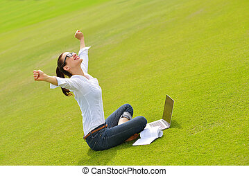 woman with laptop in park - happy young student woman with...