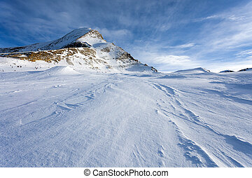 Ski slopes in Kaprun resort next to Kitzsteinhorn peak,...