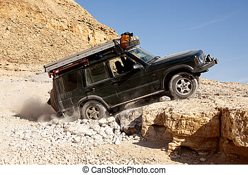LandRover on the rocks - Landrover climbing up a rock in the...
