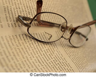 Reading material - Reading glasses on a magazine page