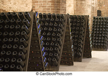 Bottles - Closeup of bottles of wine aging in an old cellar