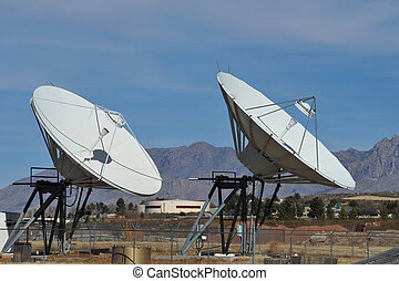 Microwave Dishes - Two micowave dishes in the mountains of...