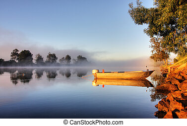 A boat in mist - Shrouded by mist a secured boat on the...