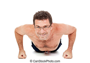 adult smiling man doing workout pushups isolated