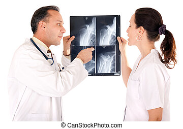 examining x-ray - medical team looking x-ray isolated on...