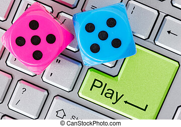 Online gaming concept Red and blue dice on the computer...