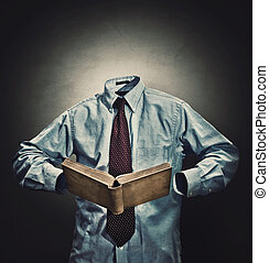 Invisible man in a business suit reading a book