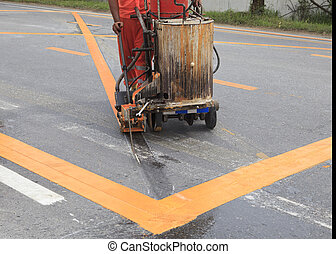 machine and worker at road construction use for road and...