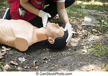 heart rate check - Demonstrating CPR on a dummy