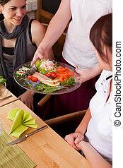 Waitress serving seafood starters - Waitress serving a...