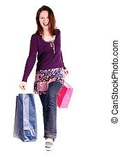 happy shopper woman - smiling woman holding shopping bags...