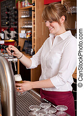 Pretty waitress serving draft beer - Pretty young waitress...