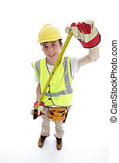 Apprentice builder or carpenter holding an outstretched...