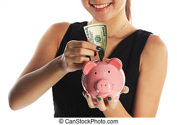 Saving for the Future with Piggy Bank and US Currency